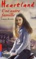 Couverture Heartland, tome 15 : Une autre famille Editions Pocket (Jeunesse) 2012
