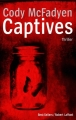 Couverture Captives Editions Robert Laffont (Best-sellers) 2014