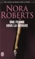 Couverture Une femme sous la menace Editions J'ai Lu 2014