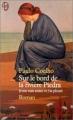 Couverture Sur le bord de la rivière Piedra je me suis assise et j'ai pleuré Editions J'ai Lu 1999