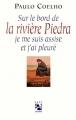 Couverture Sur le bord de la rivière Piedra je me suis assise et j'ai pleuré Editions Anne Carrière 1995