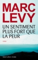 Couverture Un sentiment plus fort que la peur Editions Robert Laffont / Versilio 2013