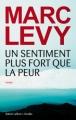 Couverture Un sentiment plus fort que la peur Editions Robert Laffont / Versilio 2013